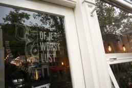Of Je Worst Lust voordeur met logo